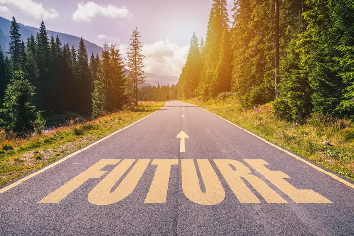 Future text on road against asphalt background in nature.