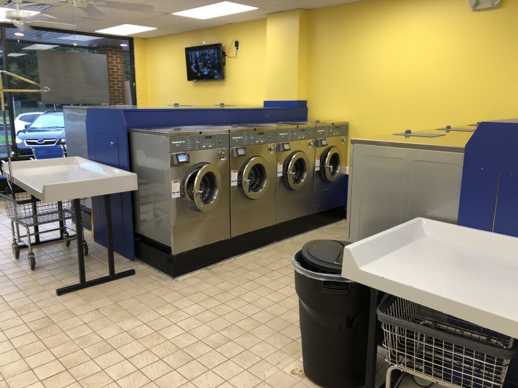 Huebsch washer and folding tables